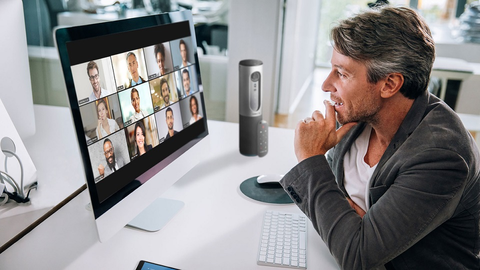 zoom video conferencing online meeting remote workers one user connected via laptop with a grid of twelve participants on screen 2400x1600 100837446 large